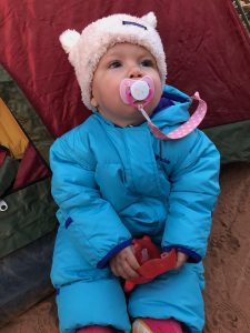 daughter camping in warm clothes
