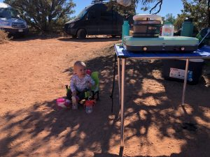 Daughter sitting in infant camping chair