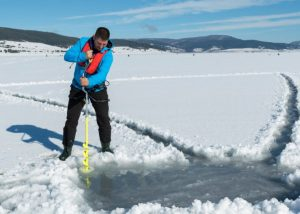 Using a Manual Ice Auger with proper stance